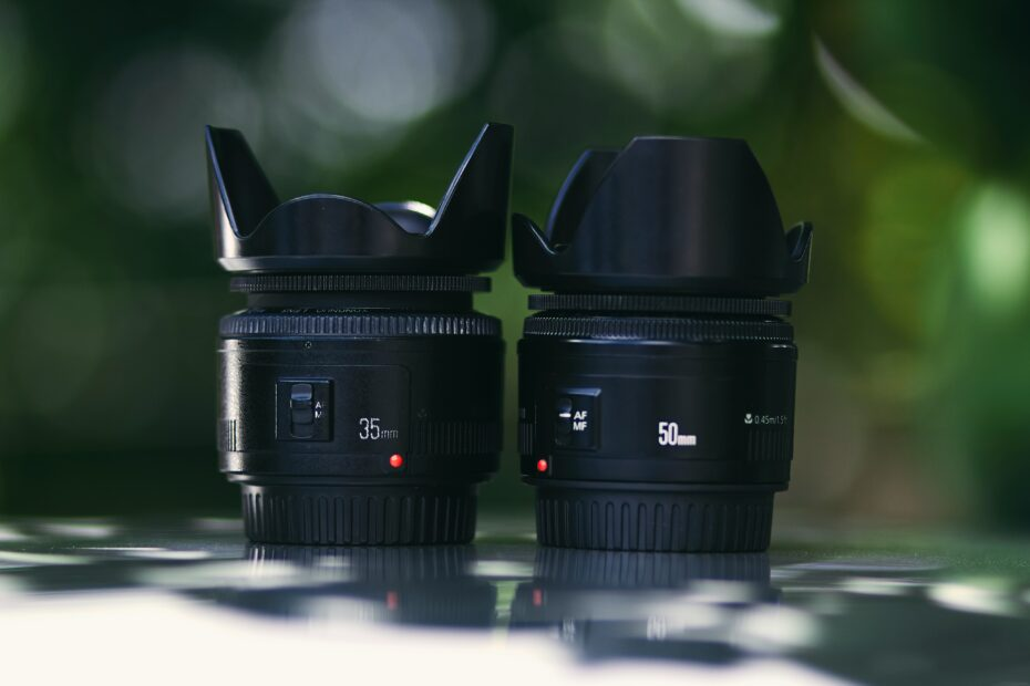 shallow focus photography of two black zoom lens